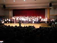 wide shot of middle school and high school choirs combined