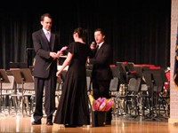senior receiving recognition flowers