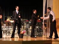 student giving teacher hand shake