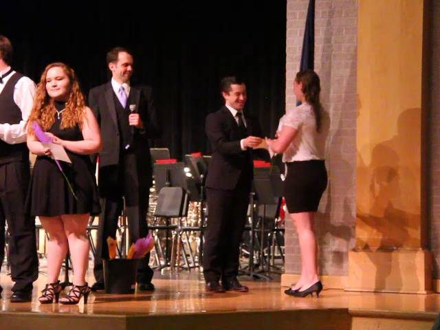 student receiving recognition award from teacher