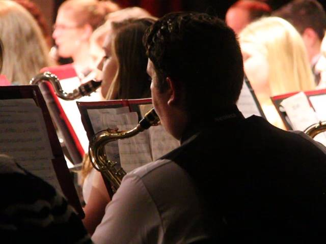 up close of students playing instruments