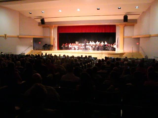 wide shot of auditorium with band performing