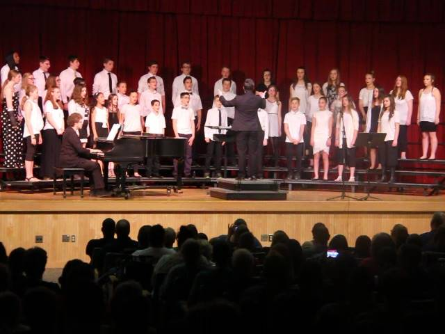 medium shot of students singing