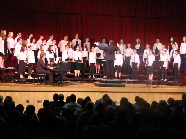 medium shot of chorus singing