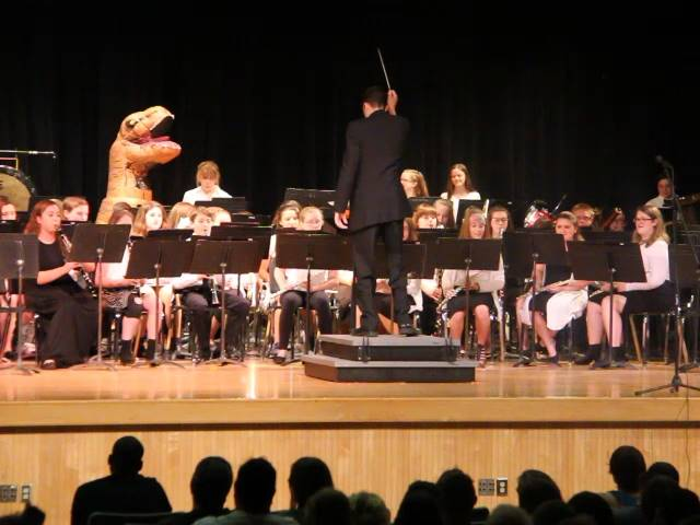 band playing with dinosaur on stage