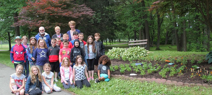 group photo of students and adults at park