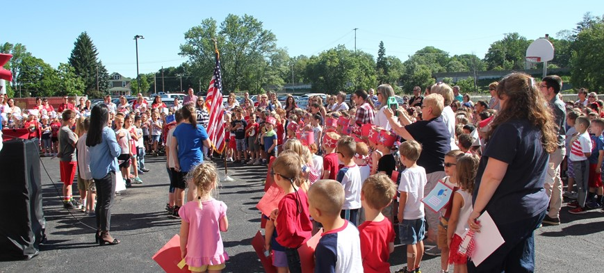 wide shot of flag day ceremony