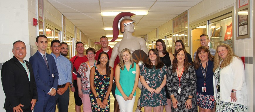 new hires and chenango valley staff by warrior statue