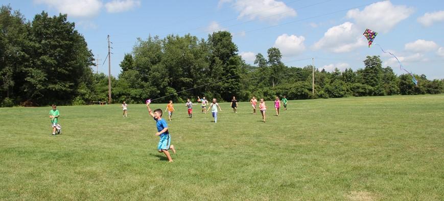 students flying kites
