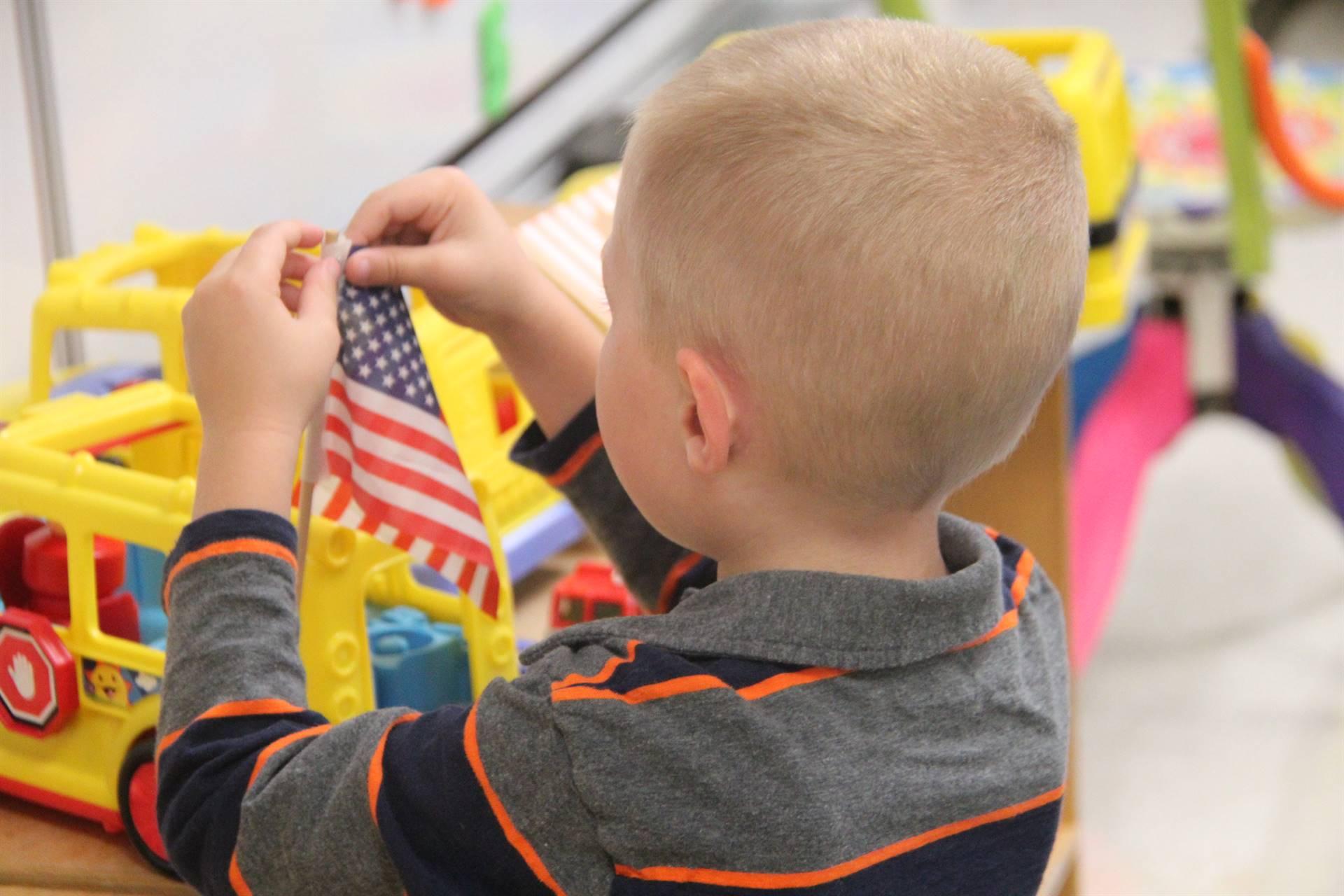 student holding flag