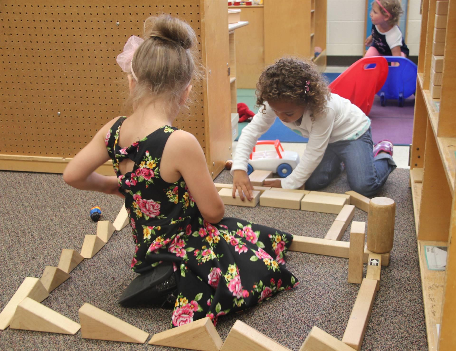 students building blocks together