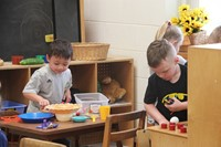 students playing in toy kitchen