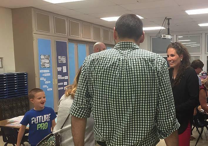 families talking in classroom