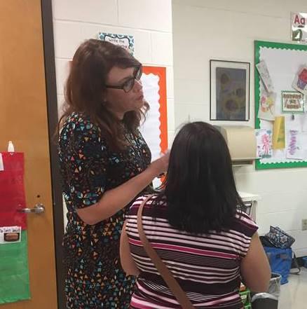 teacher talking to adult