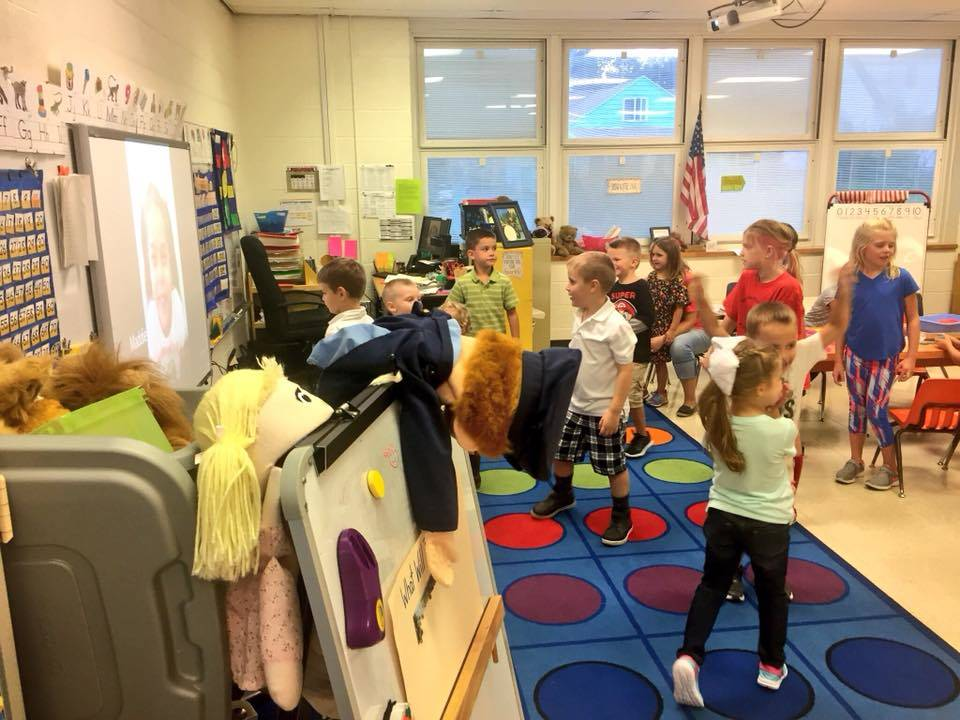 more students dancing in classroom