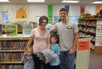 family in library