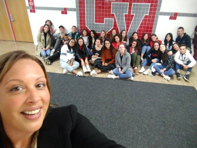 principal ostrander taking selfie with french students