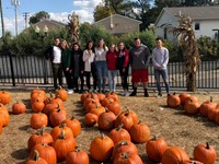 Chenango Valley French Exchange students at Cider Mill with pumpkins