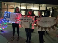 three Chenango Valley students holding welcome signs