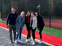 students standing on chenango valley turf