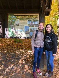 students standing next to sign for bald mountain fire tower