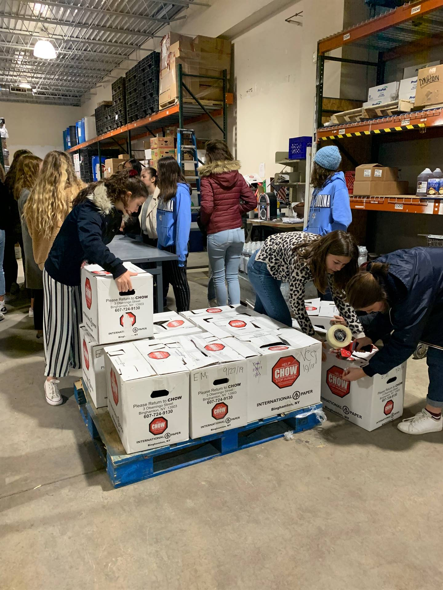 students helping at chow warehouse