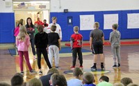 medium shot of students playing activity based on being present
