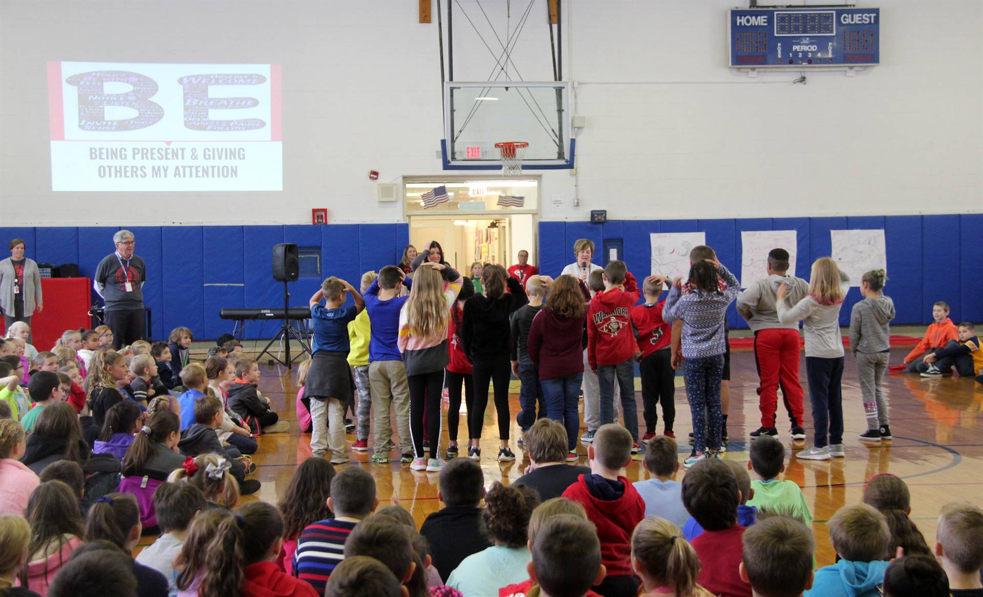 wide shot of students playing activity based on being present