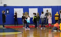 wide shot of students drawing