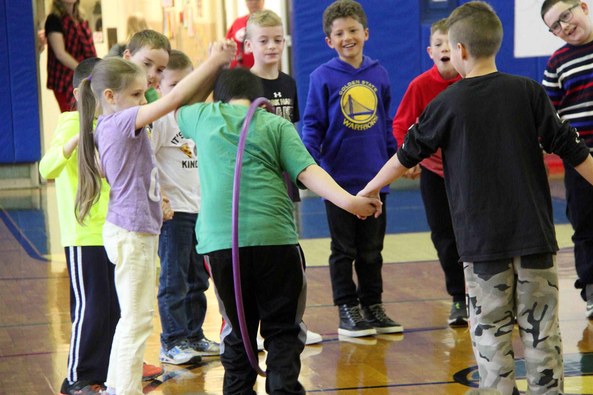 close shot of students taking part in teamwork activity