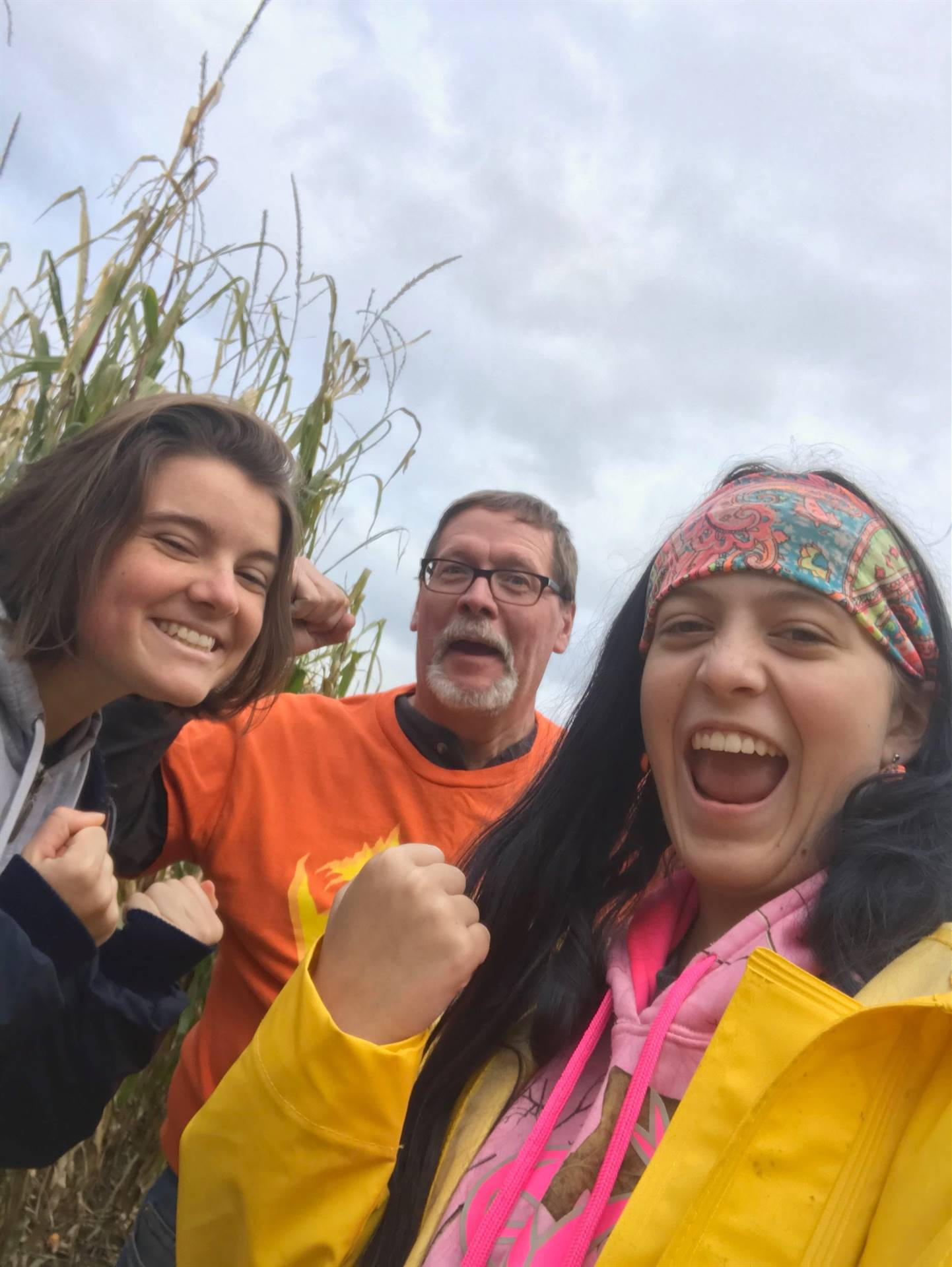 students and adult at corn maze