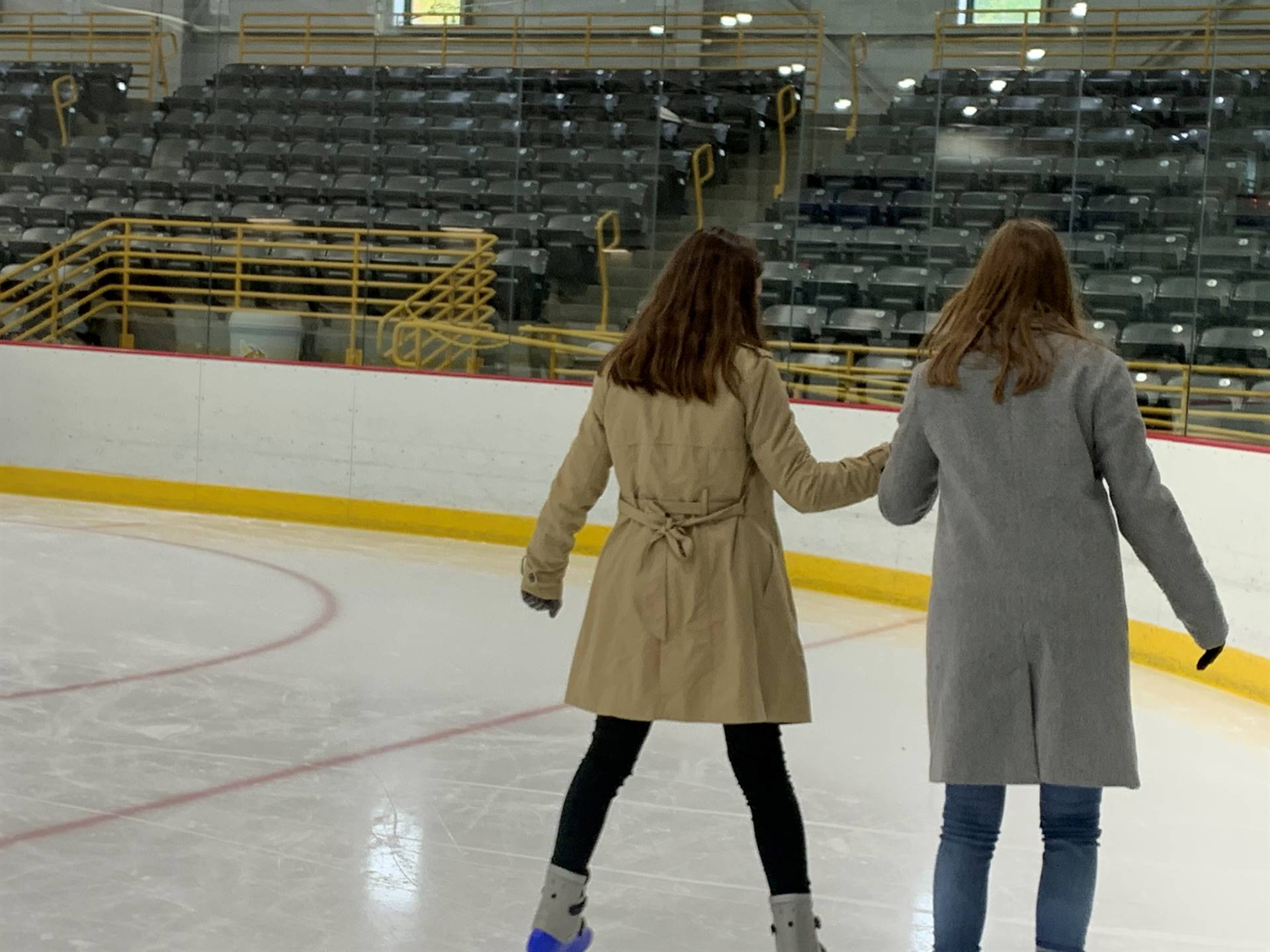 two students ice skating