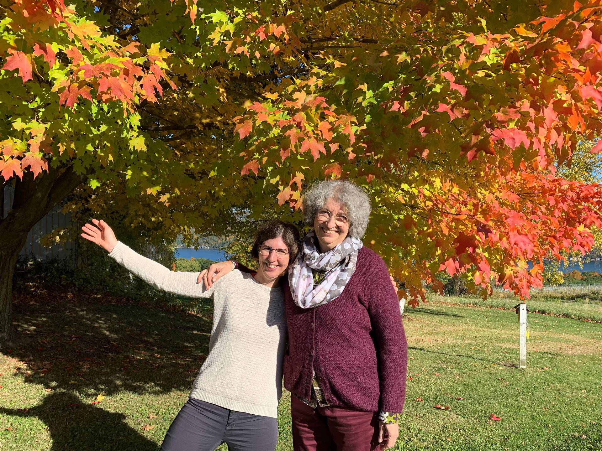 french teachers standing next to fall foliage