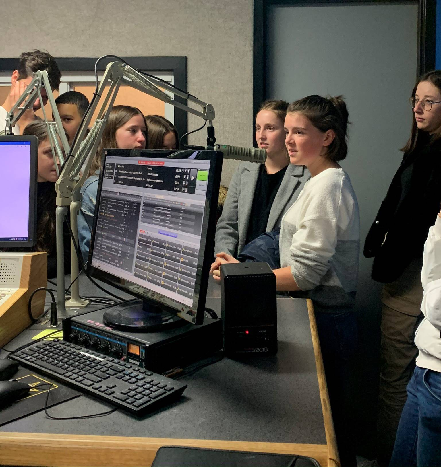 students talking to radio station host
