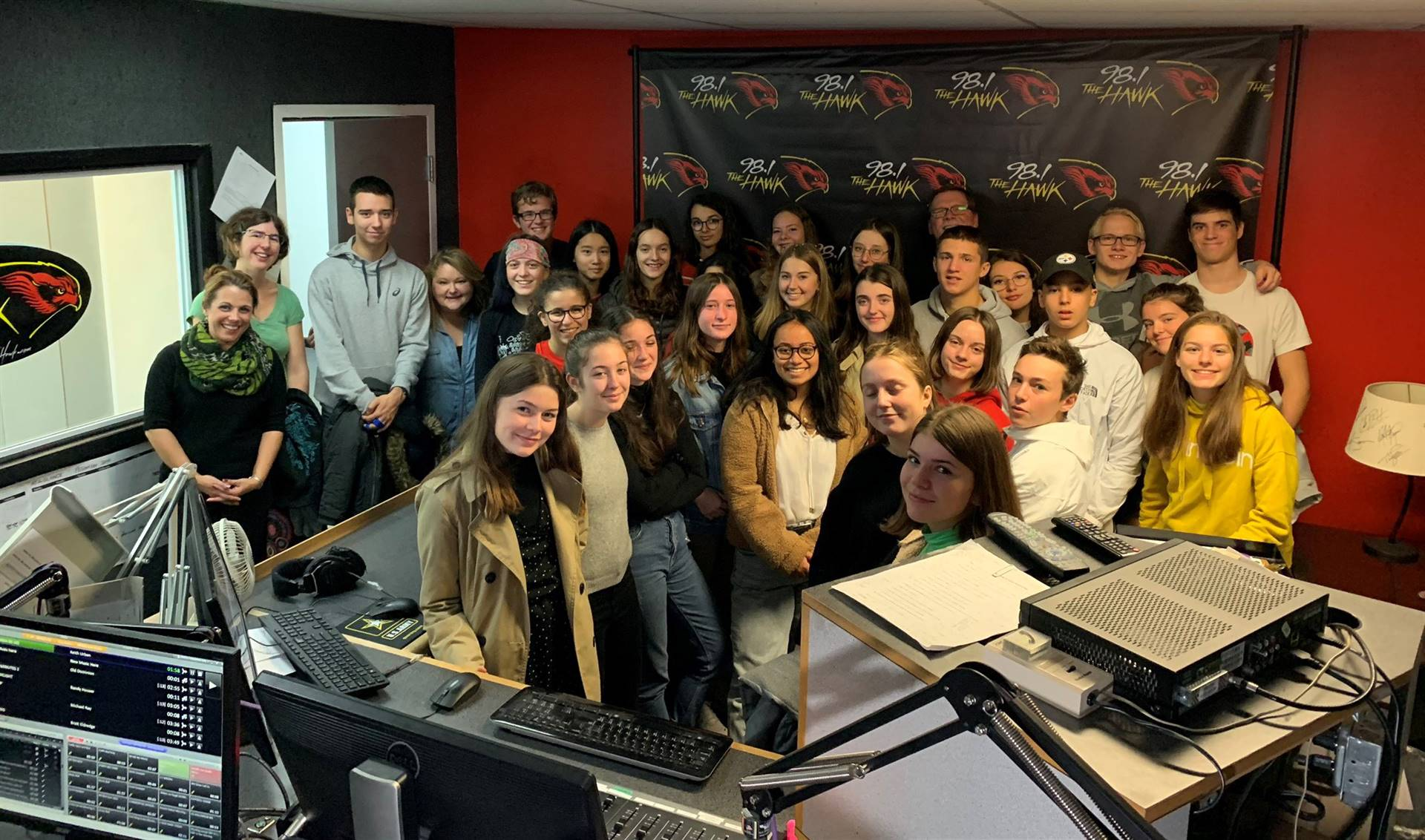 students and teachers in radio station studio