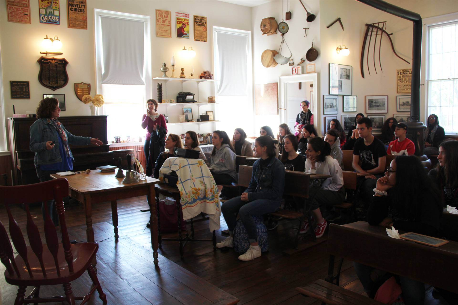 students listening to presenter in chenango school house museum