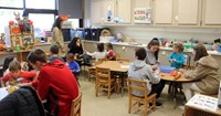 wide shot of french students and pre k students taking part in activities