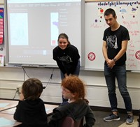 french students talking to elementary class
