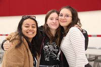 three french students smiling