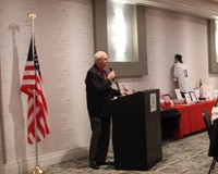 m c talking at podium