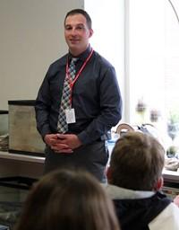 distinguished community member robert stapleton speaking to class