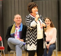 honoree maureen pratt roberts speaking at port dickinson elementary event