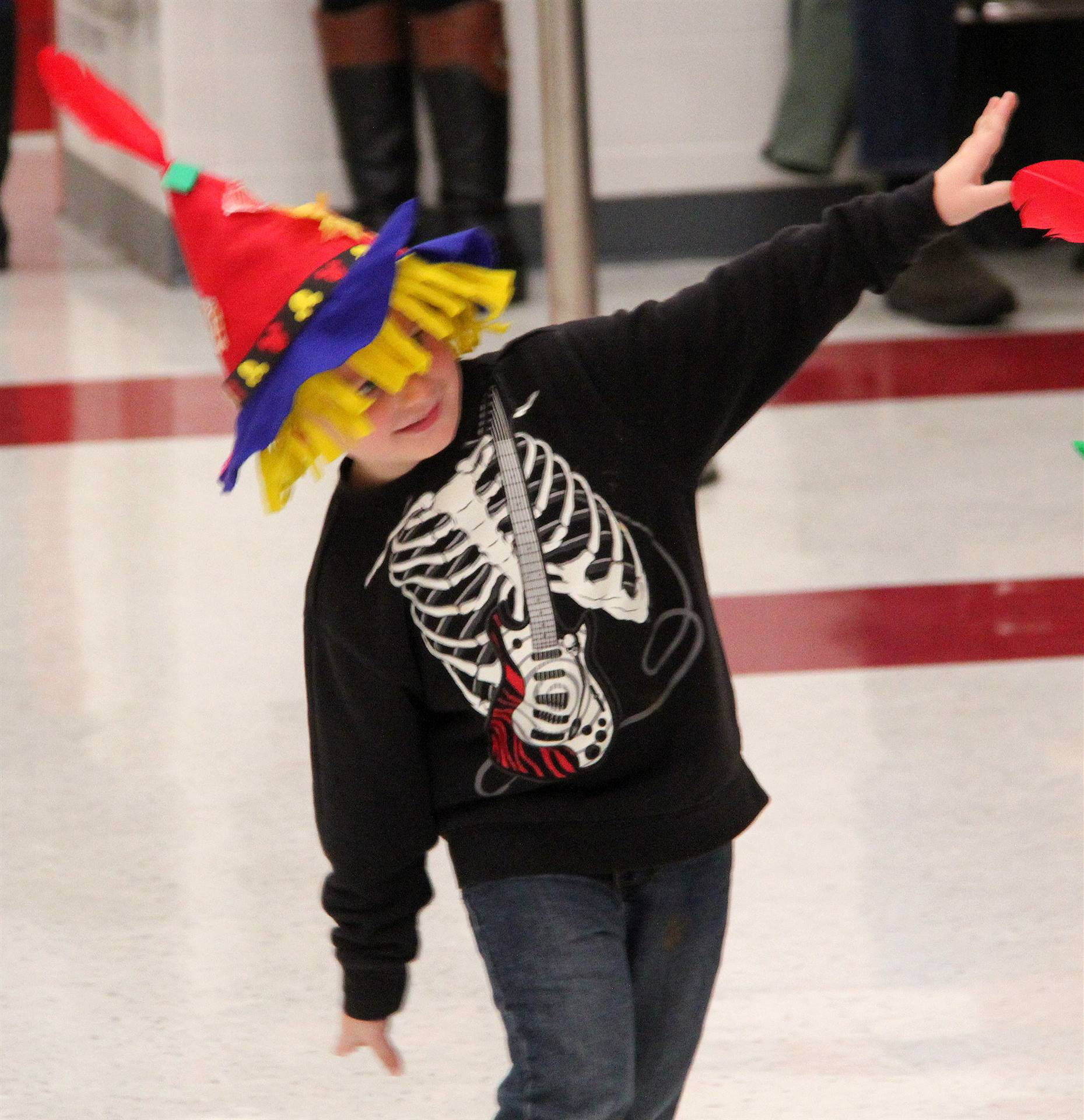 student pretending to be scarecrow at pre k halloween parade
