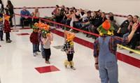 students waving to guests at pre k halloween parade