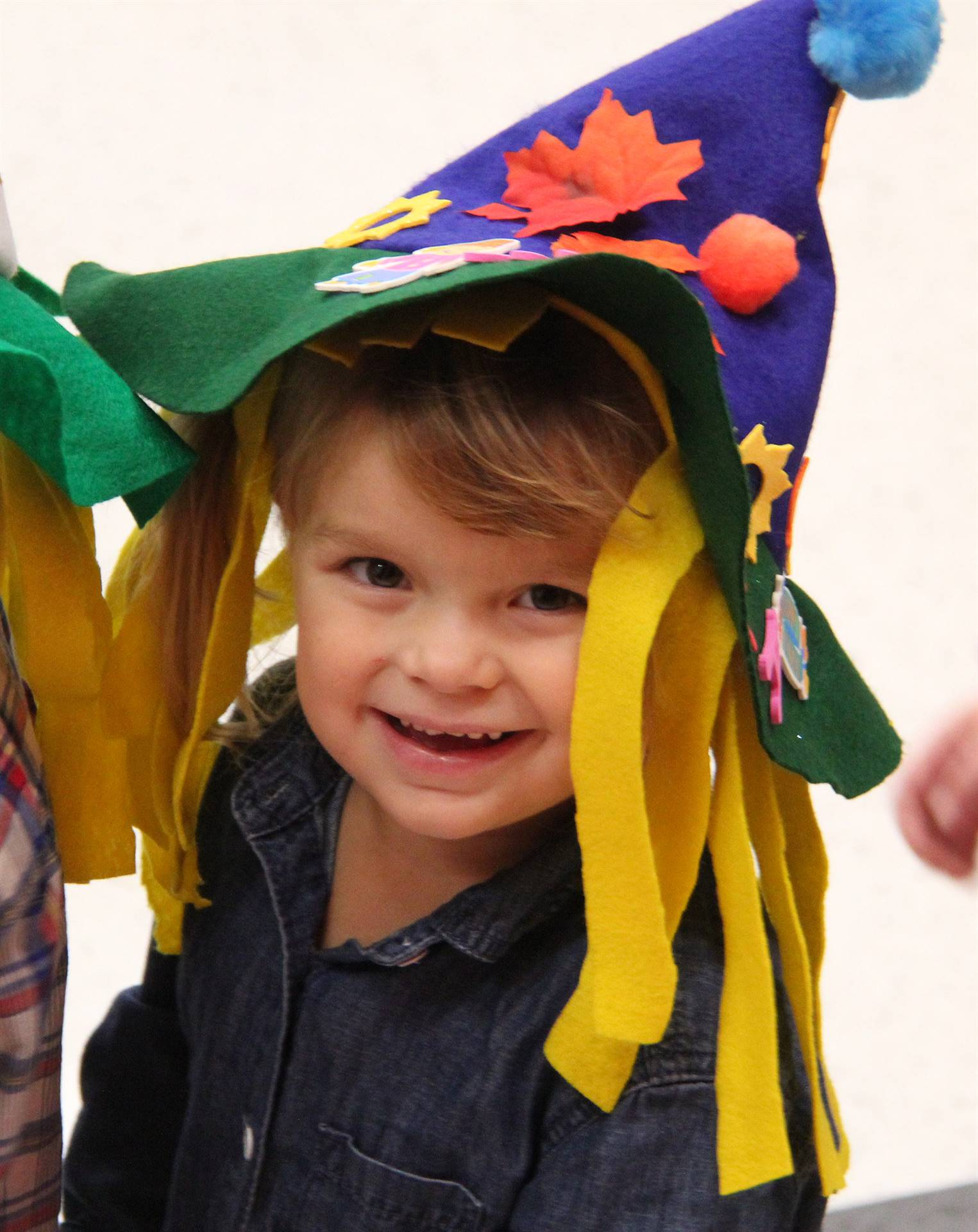 student smiling wearing scarecrow hat