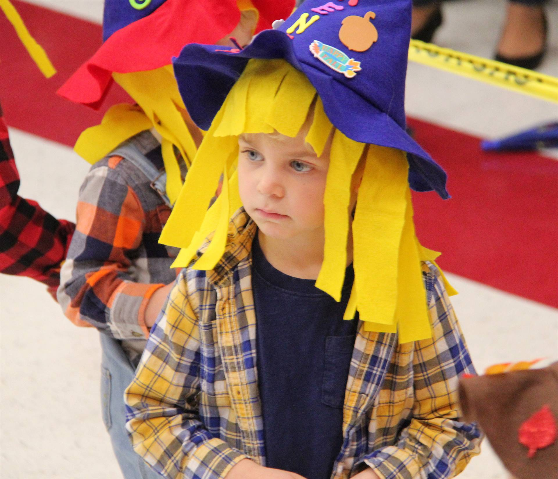 student wearing scarecrow hat