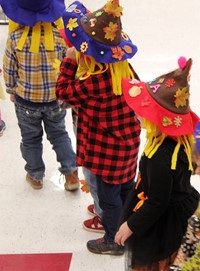 students wearing scarecrow hats