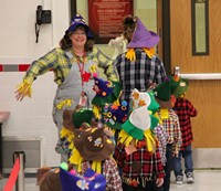 students and teacher in pre k halloween parade