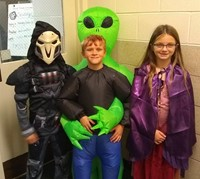 three students in costumes
