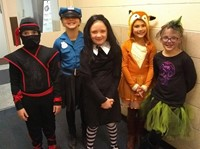 five students in costumes